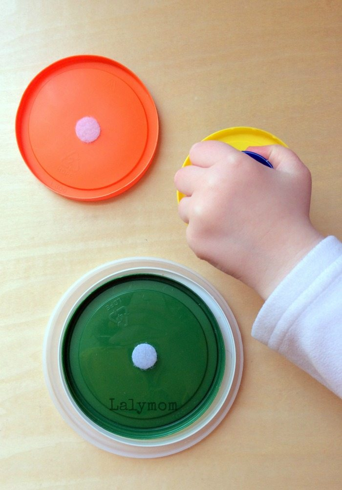10 Fine Motor Activities for Toddlers Using Velcro - Nesting Velcro Lids-  from Lalymom #SmartMarch #OccupationalTherapy #FineMotor
