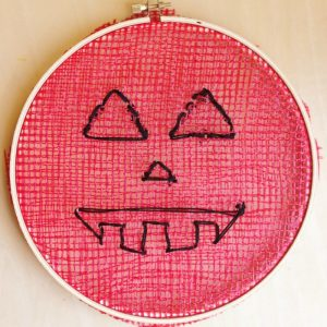 Embroidery Hoop Recycled Pumpkins - Fine Motor Halloween Craft on Lalymom.com - how cute and love the idea of getting free mesh from the grocery store!