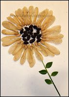 Sunflower crafted out of seeds, pine cones grass and leaves from Lalymom