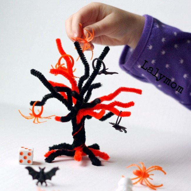 Halloween Math Game for Kids - Halloween Topple Tree Math - East to set up and fun to play. Great use for those plastic Halloween rings!