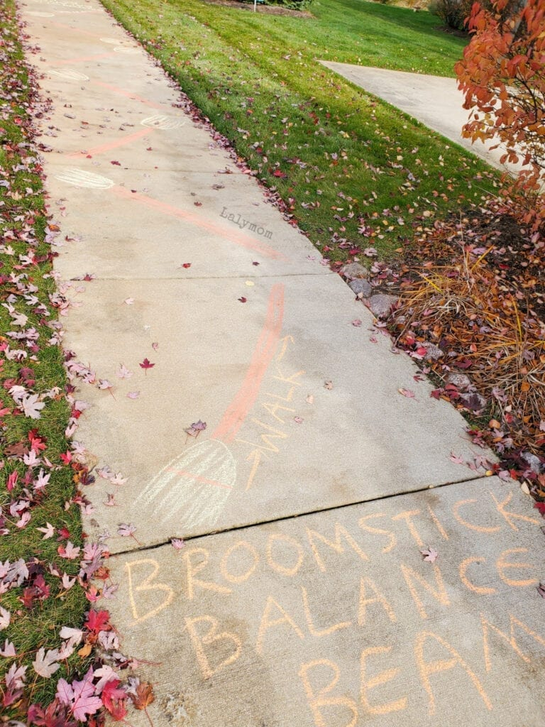 Broomstick Balance Beams Sidewalk Chalk Drawing from our Halloween Obstacle Course