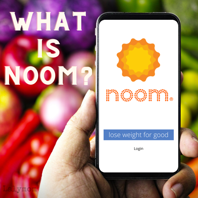 "A hand holding a mobile phone showing the Noom logo. Text superimposed over background vegetables says, ""What is Noom?"""