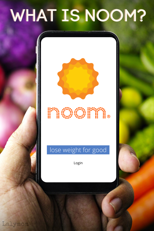 "Text superimposed in front of vegetables saying ""What is Noom?"" above a hand holding a mobile phone with the Noom logo."