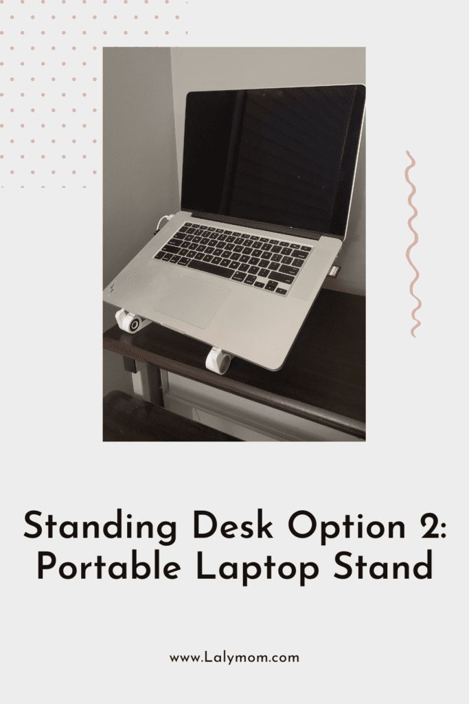 Laptop on a riser as an affordable, portable standing desk option