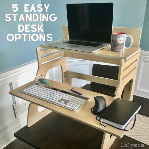 Ergonomic, wooden, two tier, tabletop standing desk with laptop, keyboard and other desk accessories. Text reads 5 easy standing desk options